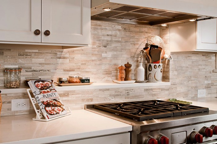 Conventional Stove White Counters White Cabinets Grey Backsplash