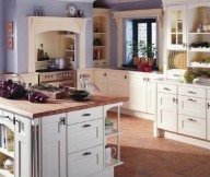 Country Style Kitchens stone floor white cabinet woden table