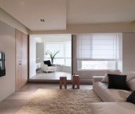 Cream Rug Cream L Sofa White Sofa Wooden Door Black Television White Blinds Wooden Small Table