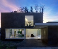 Cube architectureal building EINS house Leafless trees Glass door