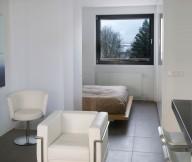 Dark floor Reykjavik apartment Glossy barstools White sofa
