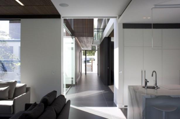 Dark floor tiles White marble kitchen countertop Z house