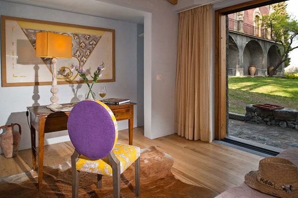 Eccentric floral print chair Wooden floor Rattan hat Ethnic wall mural