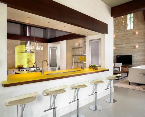 Elegant barstools Pool house Yellow kitchen island Range hood