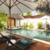 Elegant chaise lounge chairs Shady beach parasol Wooden deck Inspiring exterior pool