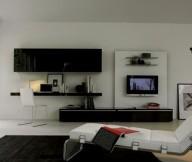 Elegant lounge chair Black desk White acrylic chair Black fur rug