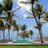 Exotic Getaway Resort with Paradise-View green lawn Caribbean Sea