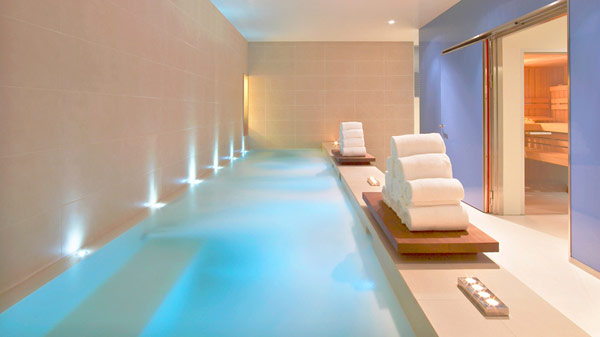 Fantastic indoor pool White towels Mezmerising hidden lights White ceramic wall