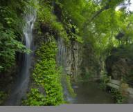 Fantastic waterfall Cool greenery Rocky cliff Peaceful greenery