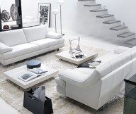 Floating staircase Box coffee tables White fur rug White sofa