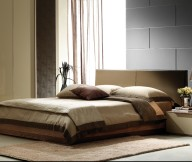 Fresh-indoor-plant-Wooden-low-profile-bed-Padded-headboard-Black-unusual-textured-beadboard