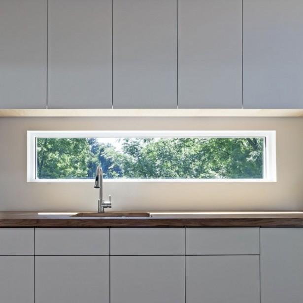 Glass WIndow Backsplash White Counters White Cabinets White Wall