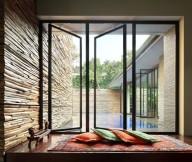 Glass Window Wooden Floor Typical Carpet Orange Cushions