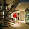 Glass banister Modern stairs Sleek white floor House Cal