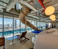 Glass bay window Glass tulip table Google Tel Aviv office