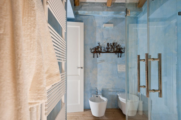 Glass door White towel rail Wooden floor Artistic wall hook