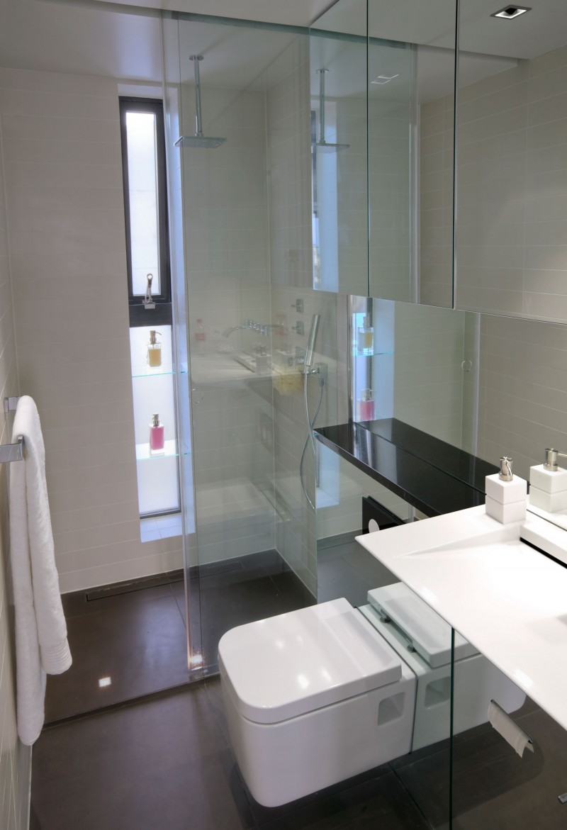 Glass shower enclosure Reykjavik apartment Modern toilet Towel rail