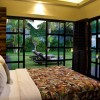 Glass-sliding-door-Elegant-bed-Tribal-pattern-quilt-Fascinating-hidden-light