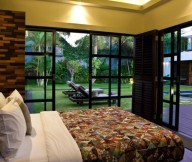 Glass-sliding-door-Elegant-bed-Tribal-pattern-quilt-Fascinating-hidden-light