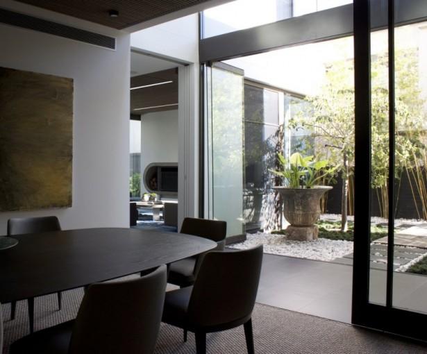 Glass sliding door Z house Fresh ornamental plant Black dining table