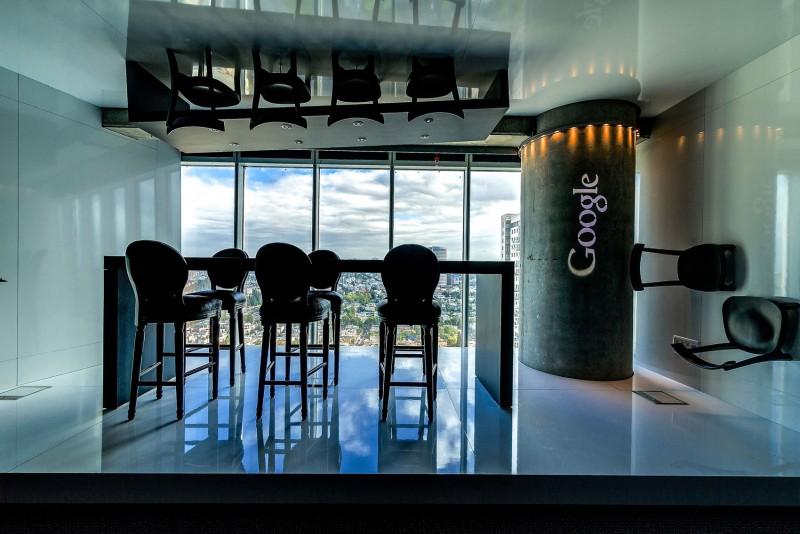 Google Tel Aviv office Black side chairs Sleek marble floor Soft ceiling light