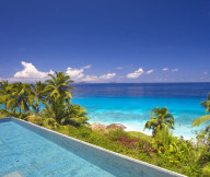 Great infinity pool Green coconut trees Peaceful ocean view White sand