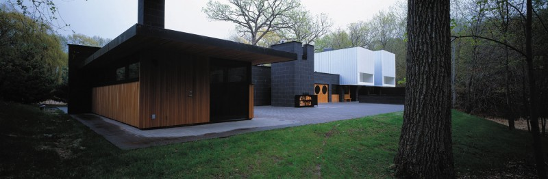 Green Lawn Black Wall FLat Roof Modern Sense