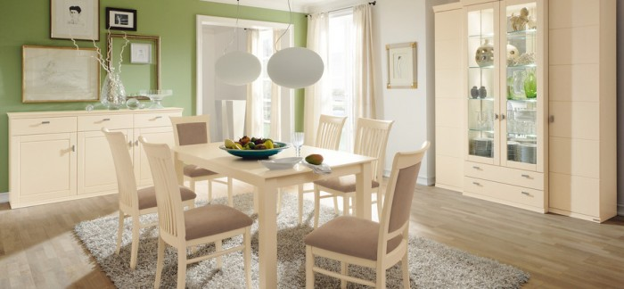 Green Wall White Dining Table Cream Cabinets White Ball Hanging Lamps