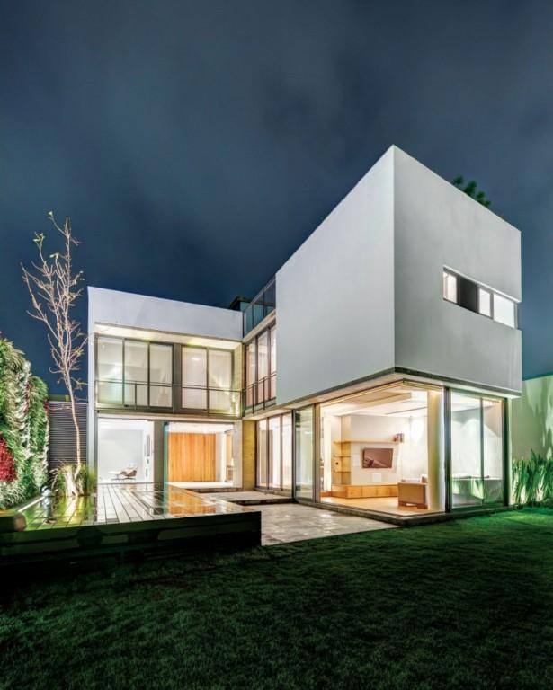 Green courtyard Casa Valna Glass bay window Leafless tree