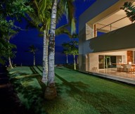 Green courtyard La punta house Glass wall Coconut trees