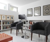 Grey Armchairs Orange Coffee Table White Floor White Wall
