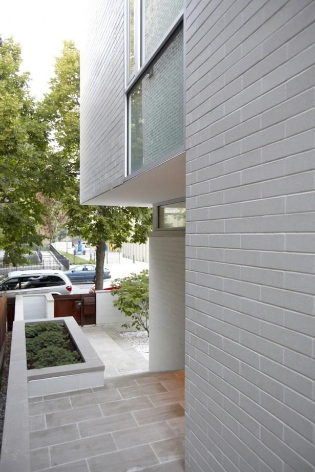 Grey Brick Wall Grey Floor Minimalist Garden  Wooden Fence Door