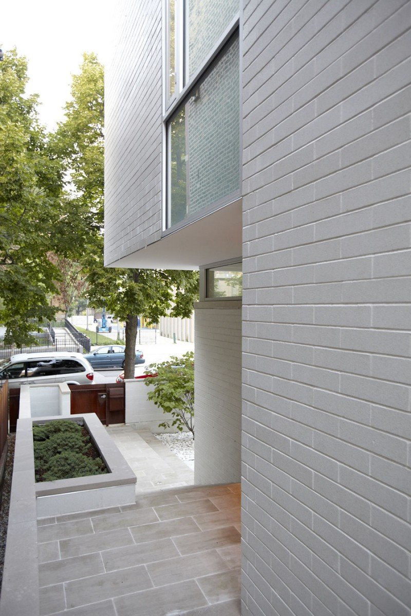 Grey Brick Wall Grey Floor Minimalist Garden  Wooden Fence Door
