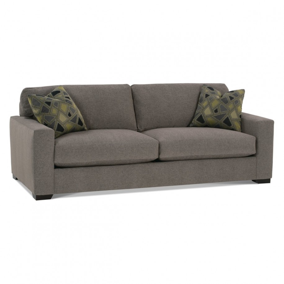 Grey sofa minimalist look mosaic motive cushions green hue for Minimalist sofa