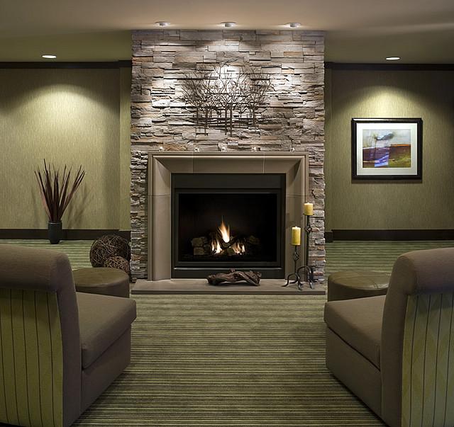 grey stone fireplace modern look stripes sofa hidden lamps. Black Bedroom Furniture Sets. Home Design Ideas