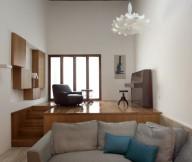 Grey sofa Unusual pendant lamp Hanging home Floral pattern carpet