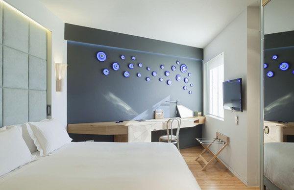Grey wall white bed Artistic and Unconventional Design white pillow Design Showcased