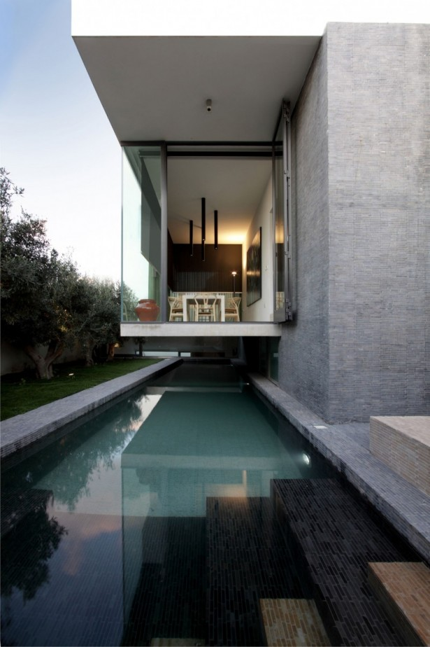 Hanging home Long swimming pool Glass wall Leafy trees
