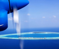 High technical plane Awesome panoramic ocean Maldives island White sand