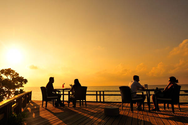 Impressive sunset view Wooden deck Outdoor furniture Wooden railing