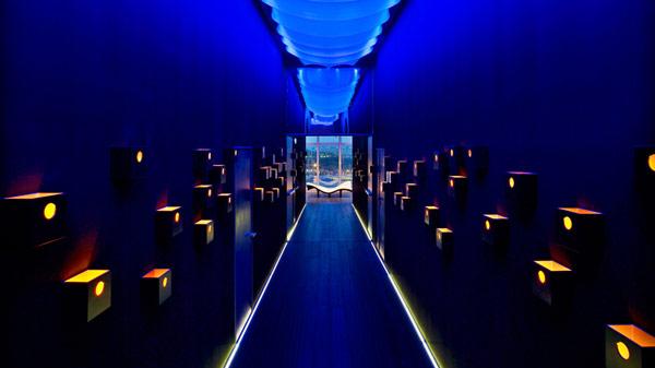 Incredible corridor Cube shaped wall lights Soft hidden lights Glass bay windows