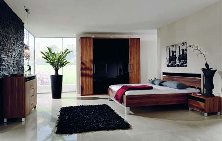 Indoor-plants-Black-stone-wall-Wooden-low-profile-bed-Shiny-white-marble