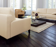 Ivory Color Couches Dark Wooden Floor WHite Flowers Glass Coffee Table