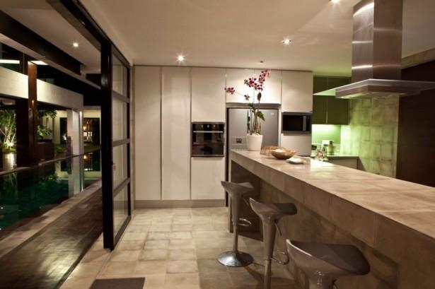 Kitchen-backsplash-light-Silver-barstools-White-marble-counterttop-Stainless-steel-range-hood