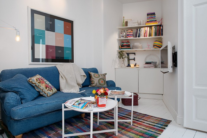 Blue Jean Sofa Colourfull Carpet  White Heirloom Apartment