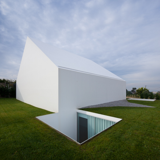 House With The Simplest Of Forms Stark Facade With Opening