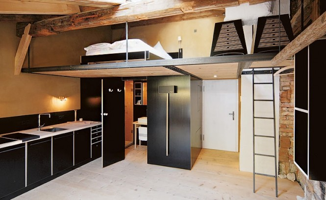 The Berge Winter Retreat Mezzanine Level Black Cabinets