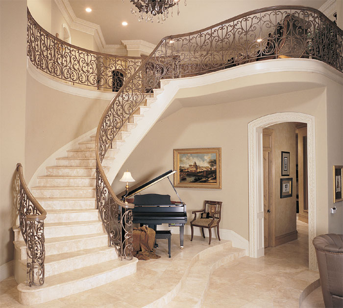 Old World Interior Design With Wrought Iron Stair Railing
