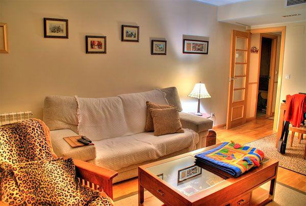 Cushy sofa Laminate flooring Warm table lamp Wooden table