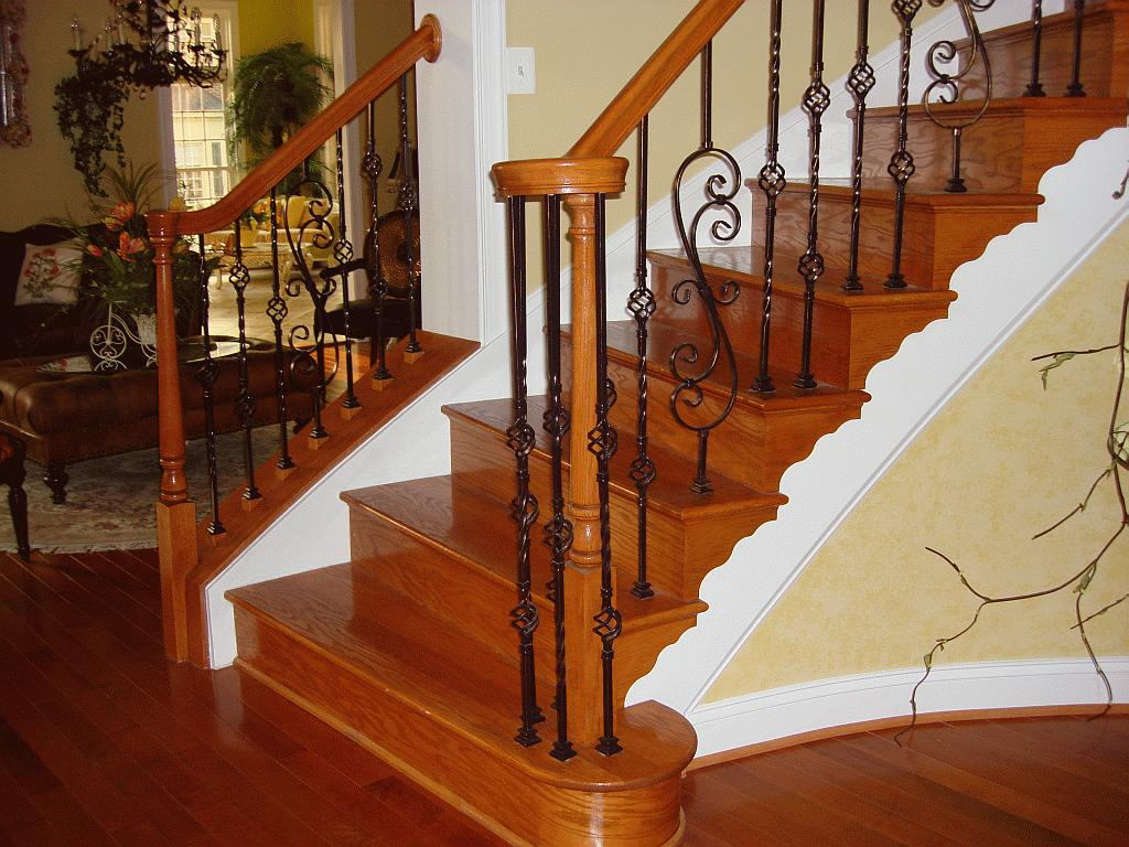 wooden handrails with wrought iron design